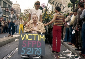 Pushing Mr. Sarah in the '79 Parade a month after he was beaten in the White Night Police Riot. After several brain surgeries, 4 weeks in General and my skilled handling of the chair, he started to recover.