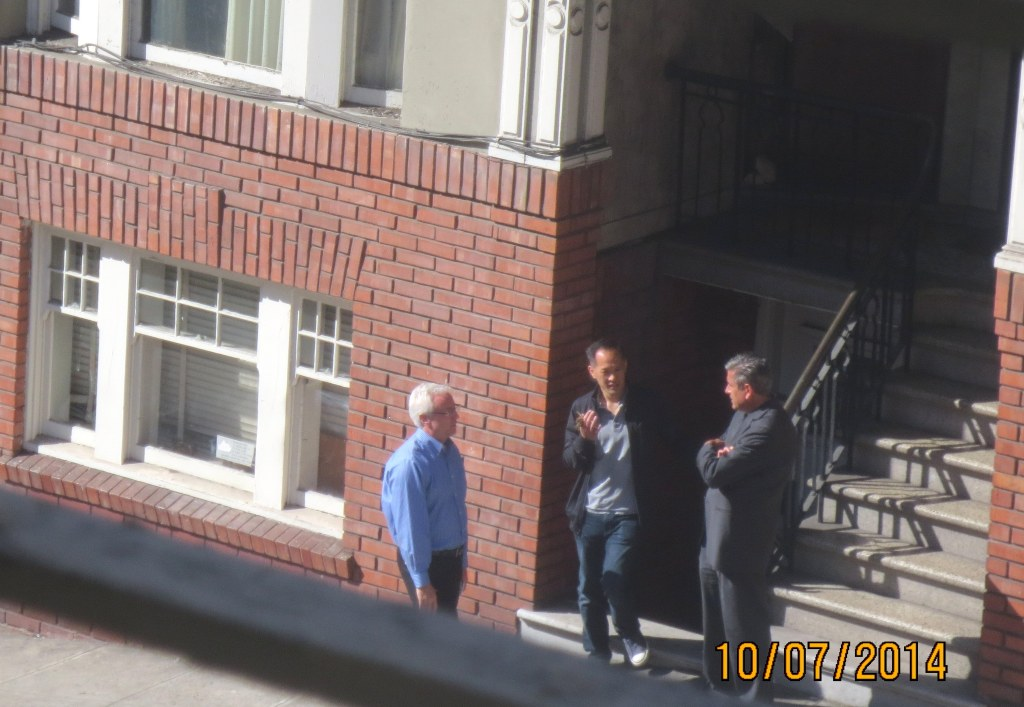 A typical San Francisco street scene these days: speculators speculating