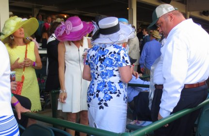 The finishing touch to any showy hat is a dashing escort.