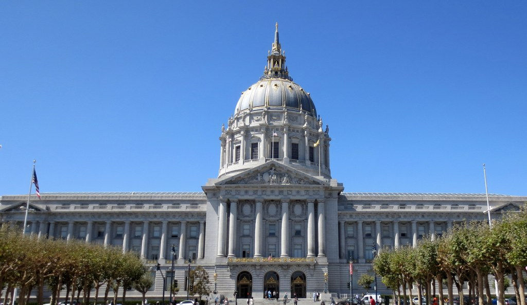 "After the 1906 earthquake many doubted that a city should be rebuilt on a site prone to natural disasters. Civic leaders forged ahead anyway with a City Hall that was grander than anything previously imagined. Its dome, fifth largest in the world, stands as a defiant middle finger ""fuck you"" to the naysayers."