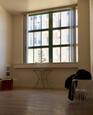 The room is small, approximately 12x14, but high ceilings, huge windows, and no furniture make it appear smaller.