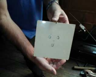 Spoils from the Big War. Eric's said his Dad lifted this tile from Hitler's Bertchesgaden and these were bullet holes. Then he backtracked, said I fabricated the bullet story. I don't fabricate. Just ask my buddy Cape.